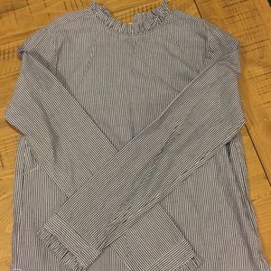 Blue and white striped blouse.